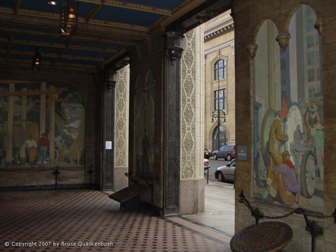 Several of True's murals are shown in the entrance lobby of the Quest building in Denver.